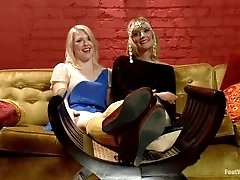Two blonde teens worship each...